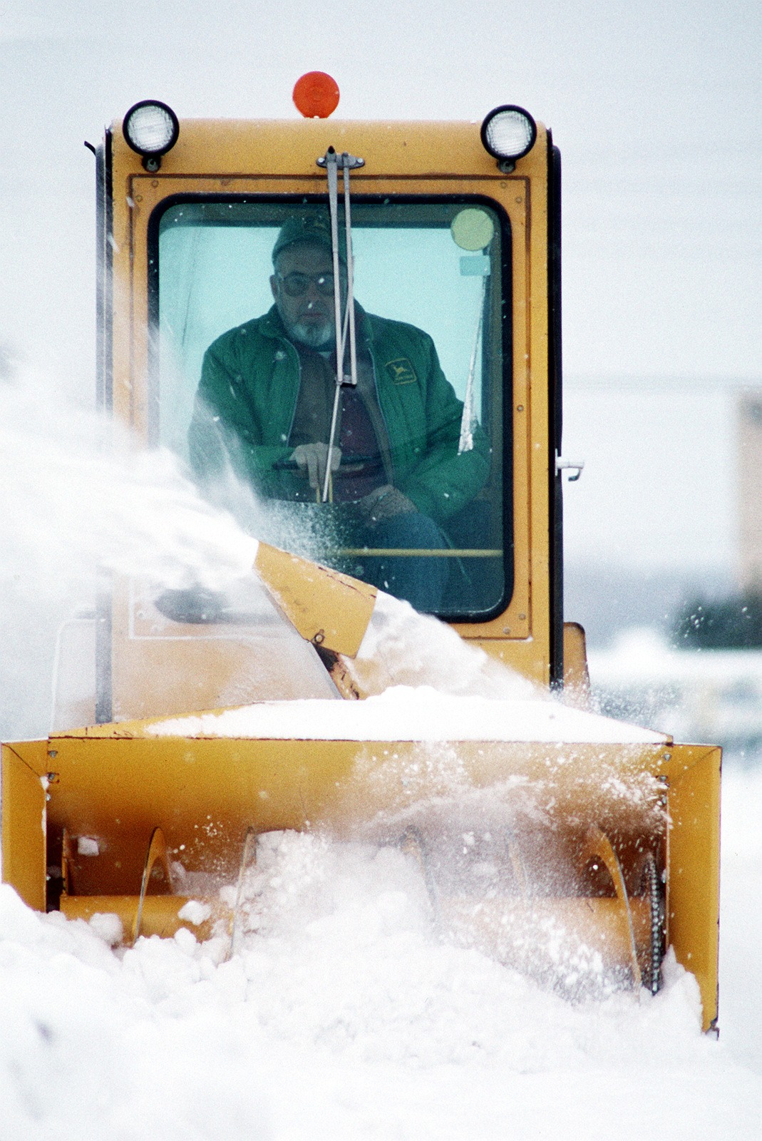 A snow blower is used to start the clearing off of one of the tarmacs at Naval Air Station Brunswick even before the snow is over.